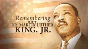 Martin Luther King, Jr in from on American flag